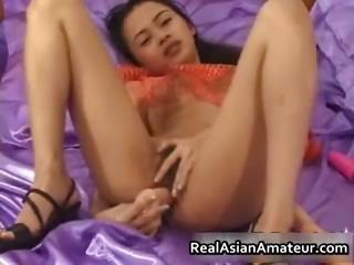 Petite asian babe strips and..